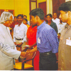 Shaking hands with Dr. APJ Abdul Kalam, then the President, at rastrapati Vabhan