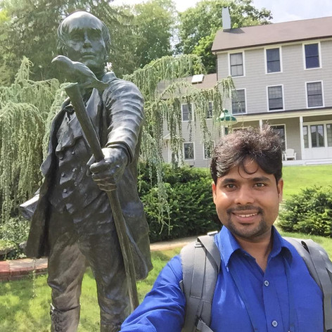 In front of the statue of Charles Darwin