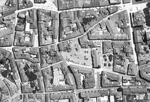 The site is a fragmented city block that resulted from the demolition of an old factory. Aerial view.