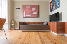 The daybed is an afzelia wood panel that rises from the wall. (photo: Tomoya Fujimoto)
