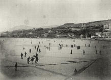 View of St. Nicolas Hill across the icy lake (c. 1905).