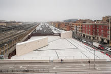 The competition site, situated between the historic center of Bologna and the urban expansion of the early 1900s, is marked by two technical chimneys of a railway station.