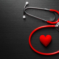 Stethoscope doctor with red heart on bla