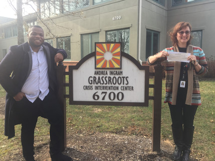 PASTOR BRANDON AT THE GRASSROOTS CRISIS INTERVENTION CENTER PRESENTING A CHECK ON BEHALF OF TRANSFORMATION CHRITIAN FELLOWHIP  HEART FOR THE HARVEST 2018
