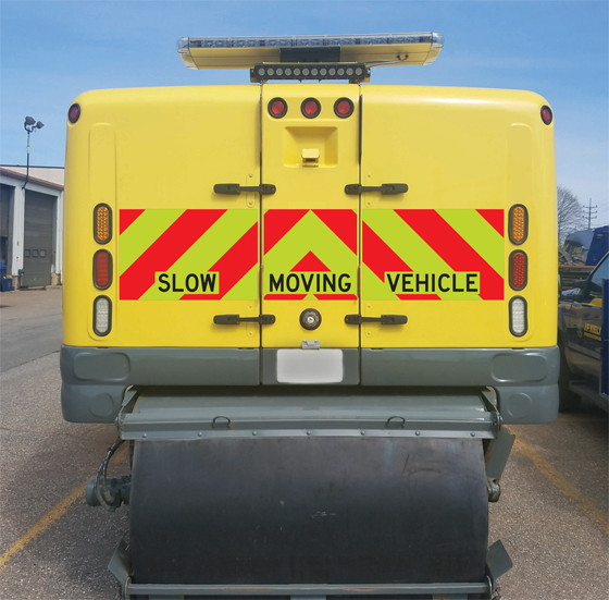 Custom size prefab chevron on the back of a street sweeper