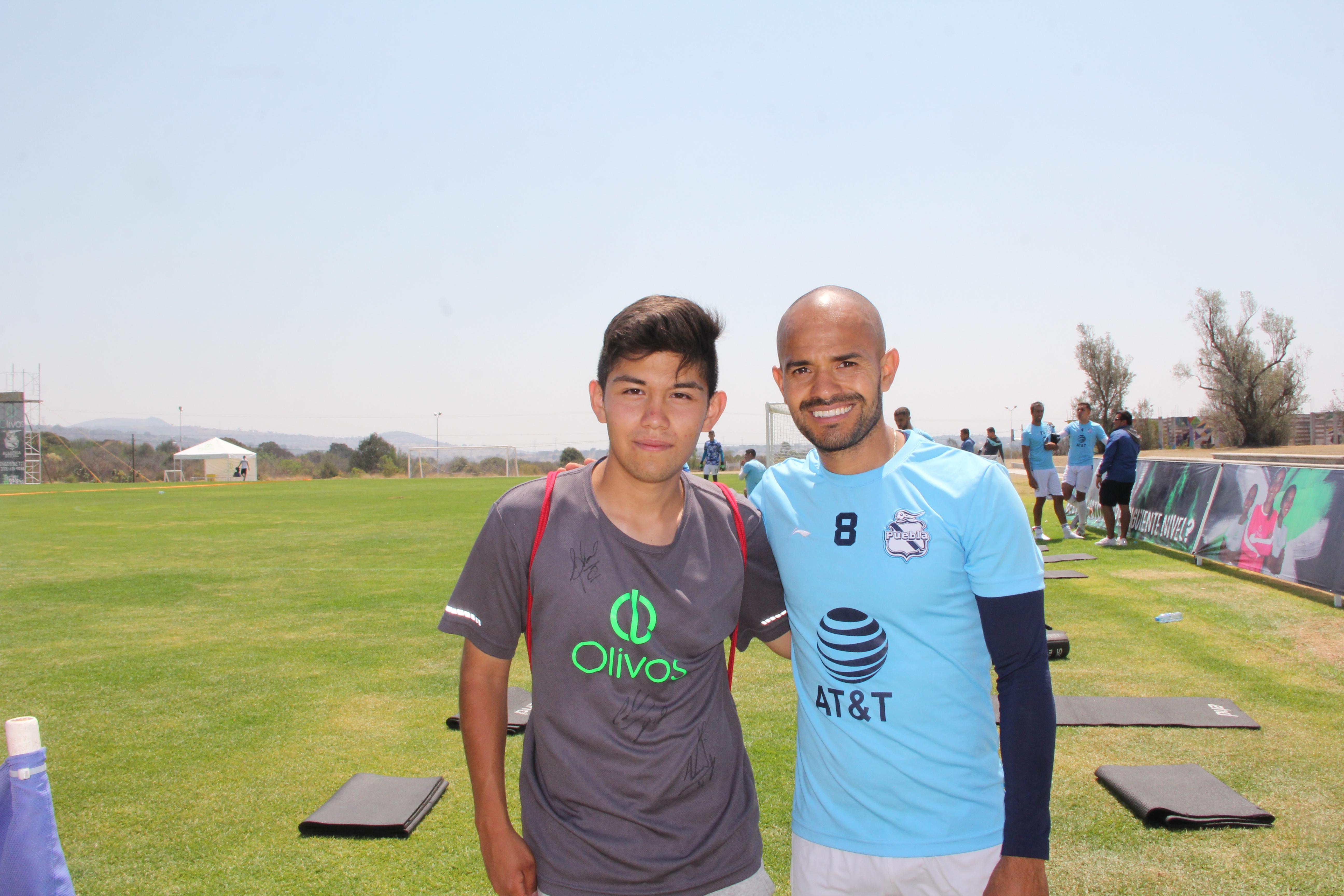 Javier Acuña con alumno Olivos