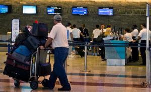 A passenger walks past the British Airways counter…