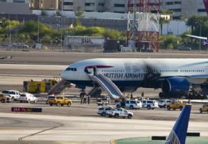 Emergency vehicles surround a British Airways plane…