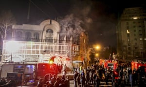 Smoke rises as Iranian protesters angry over the killing of Nimr al-Nimr set fire to the Saudi embassy in Tehran.