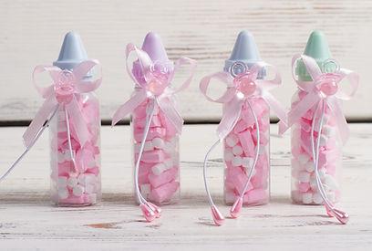 Bottiglie di colore rosa di bambino