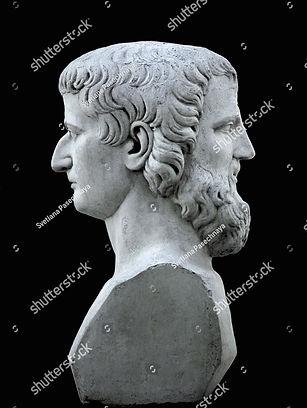 stock-photo-janus-sculpture-on-a-black-b
