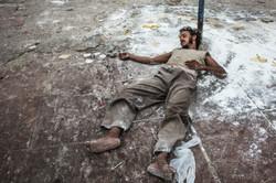 A homeless man sleeps rough in India
