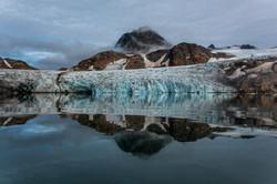 A glacier meets the mirror like sea