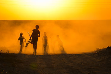 Children appearing through th dust in Moynaq, Uzbekistan
