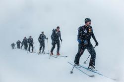Teams ski tour through blizzards