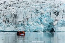 A calving glacier meets the sea