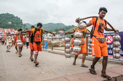 Pilgrims carry pots of water, India