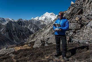 Tom McShane operating a DJI phantom drone in the mountains in Bhutan