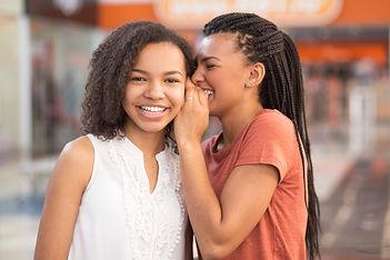 closeup-two-nice-black-girls-sharing-sec