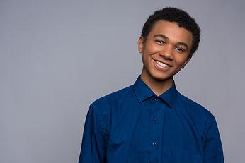 happy-african-american-teenager-denim-sh