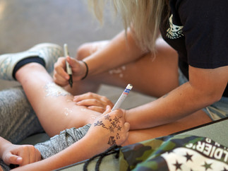 Kids drawing on each other.jpg