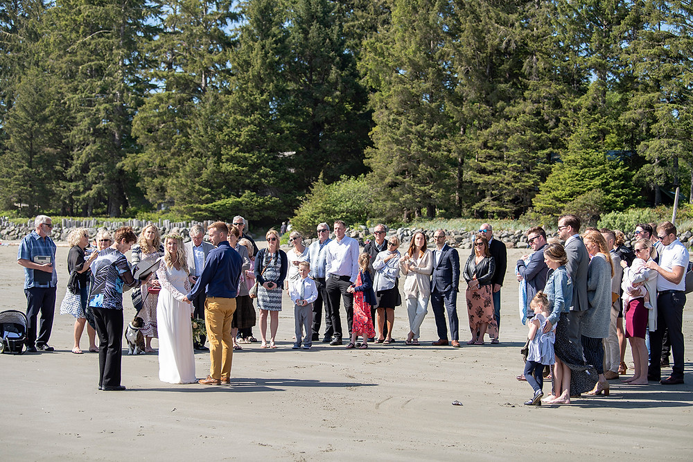 wedding ceremony Tofino on Chesterman Beach. Photographed by Kaitlyn Shea