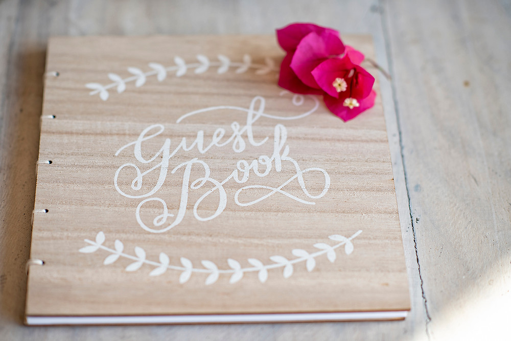 guest book for destination wedding in Playa Grande, Costa Rica. Photographed by Kaitlyn Shea.