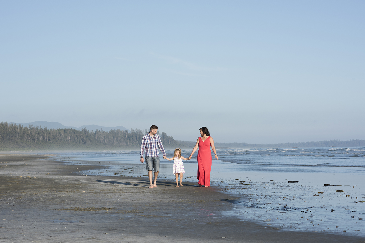family on beach in Tofino