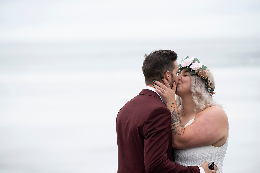 Couple shares a kiss after renewing vows in Tofino. Photographed by Kaitlyn Shea.