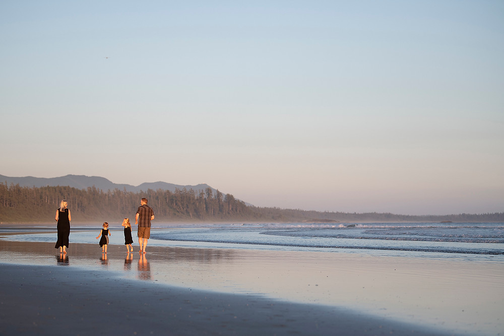 Family walks on the beach together during family photos in Tofino. Photographed by Tofino photographer Kaitlyn Shea.