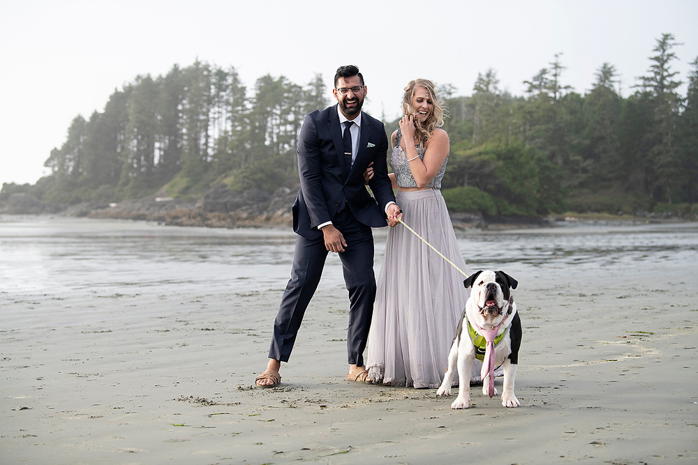 Newly wed couple and their dog at their small wedding in Tofino. Photographed by Tofino wedding photographer Kaitlyn Shea.