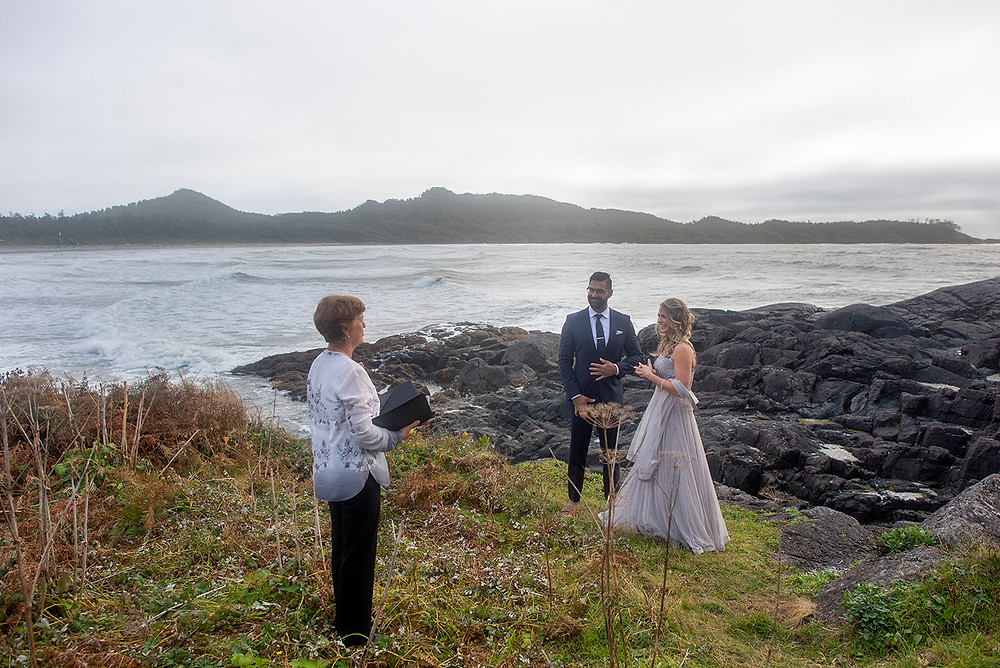 Bride and groom say their vows at their small wedding in Tofino. Photographed by Tofino wedding photographer Kaitlyn Shea.