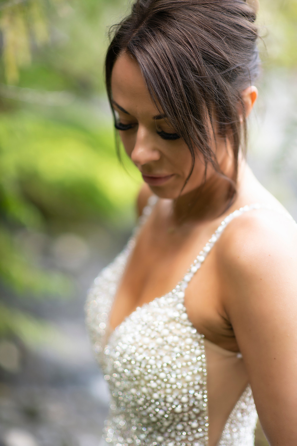 Stunning bride at an Newly weds kiss in the forest at an Couple embraces in the fporest at an Bride and groom have their first kiss at an Beautiful beach ceremony at an Bride and groom hold rings during an elopement in Tofino. Photographed by Kaitlyn Shea.