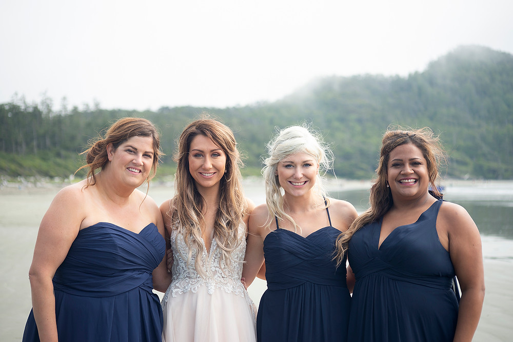bride and her bridesmaids at beach wedding in Tofino. Photographed by Kaitlyn Shea