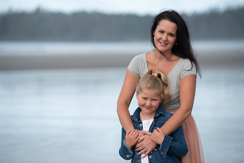 Mother and son smile for the camera during a family photography session. Photographed by Kaitlyn Shea.