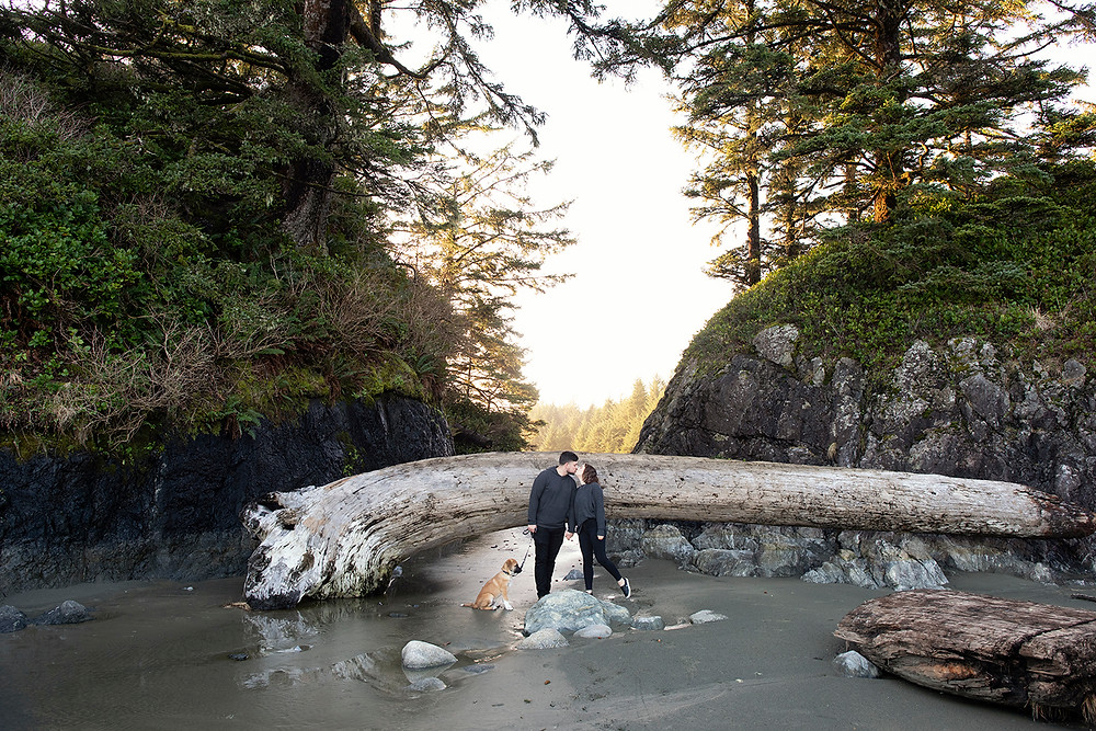 Couple kisses at Long Beach during their Tofino engagement photos. Photographed by Tofino photographer Kaitlyn Shea.