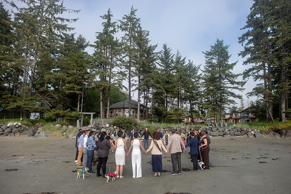 wedding guests on Chesterman Beach, Tofino. destination wedding in Tofino. Photographed by Kaitlyn Shea.