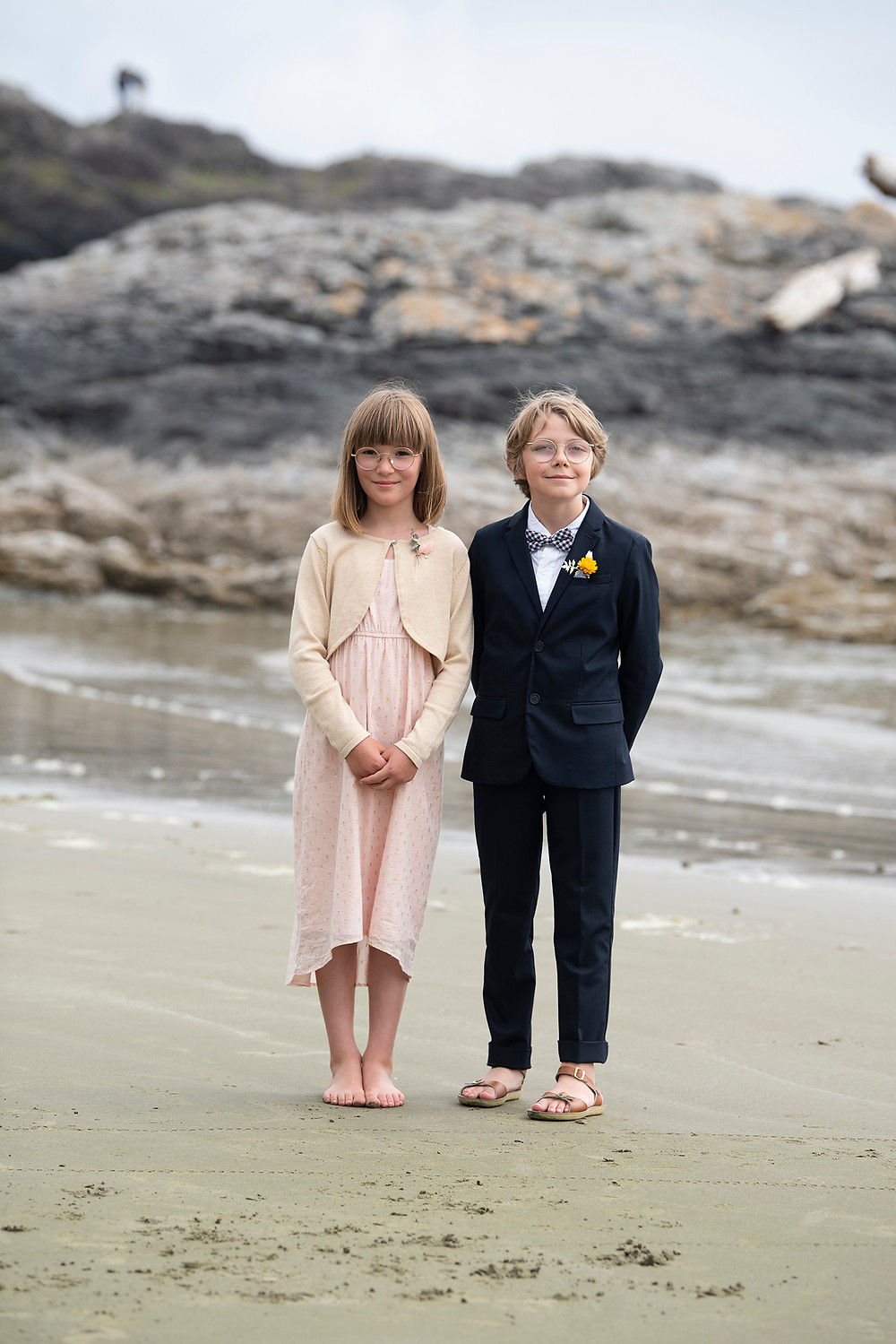 Children stand on Long Beach at a Tofino beach elopement. Photographed by Kaitlyn Shea.