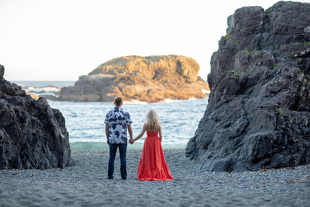 engaged couple on the beach in Tofino. Photographed by Kaitlyn Shea.