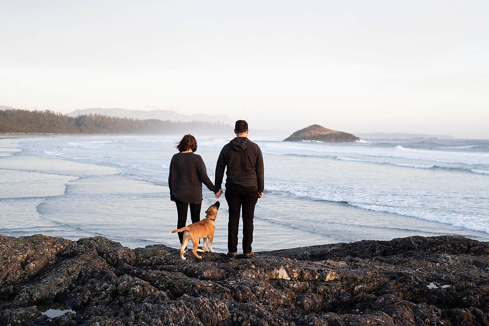 Couple looks out at the ocean during their Tofino engagement photos. Photographed by Tofino photographer Kaitlyn Shea.