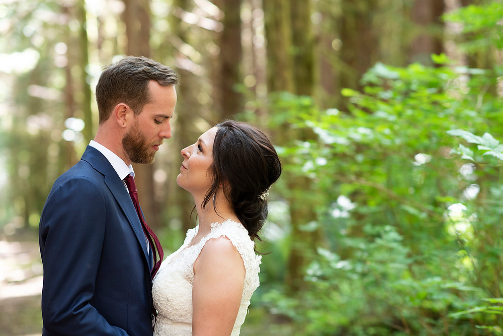 Happy couple at their forest wedding in Tofino. Photographed by Kaitlyn Shea.