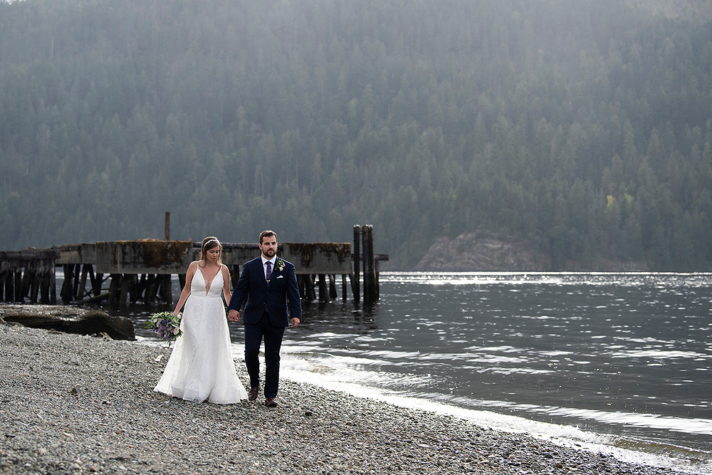 Bride and groom walk hand in hand at their August wedding on Vancouver Island. photographed by Kaitlyn Shea.
