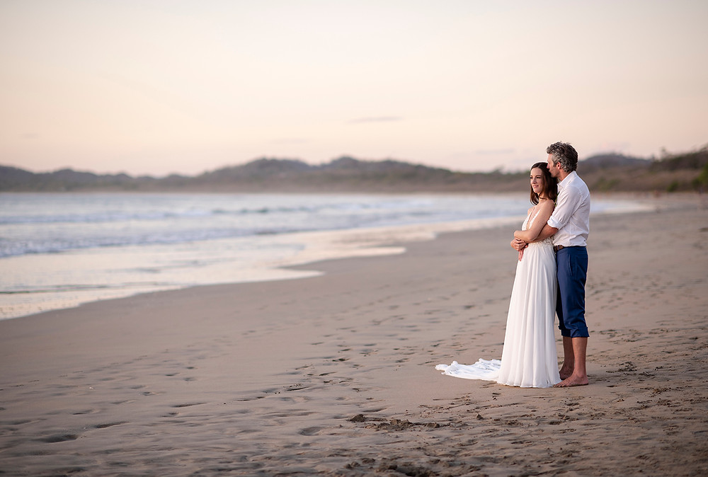 Man kisses his bride at their destination wedding in Playa Grande, Costa Rica. Photographed by Kaitlyn Shea.