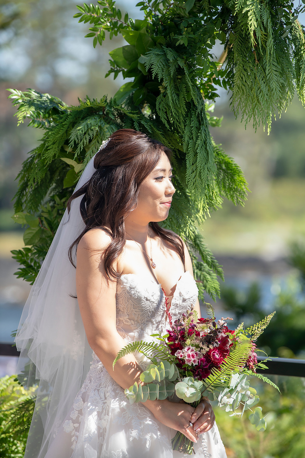 Bride under archway at her Ucluelet wedding at Black Rock Resort. Photographed by Ucluelet Photographer Kaitlyn Shea.