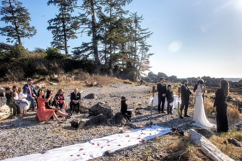 Sunny wedding ceremony at Ucluelet elopement. Photographed by Kaitlyn Shea.