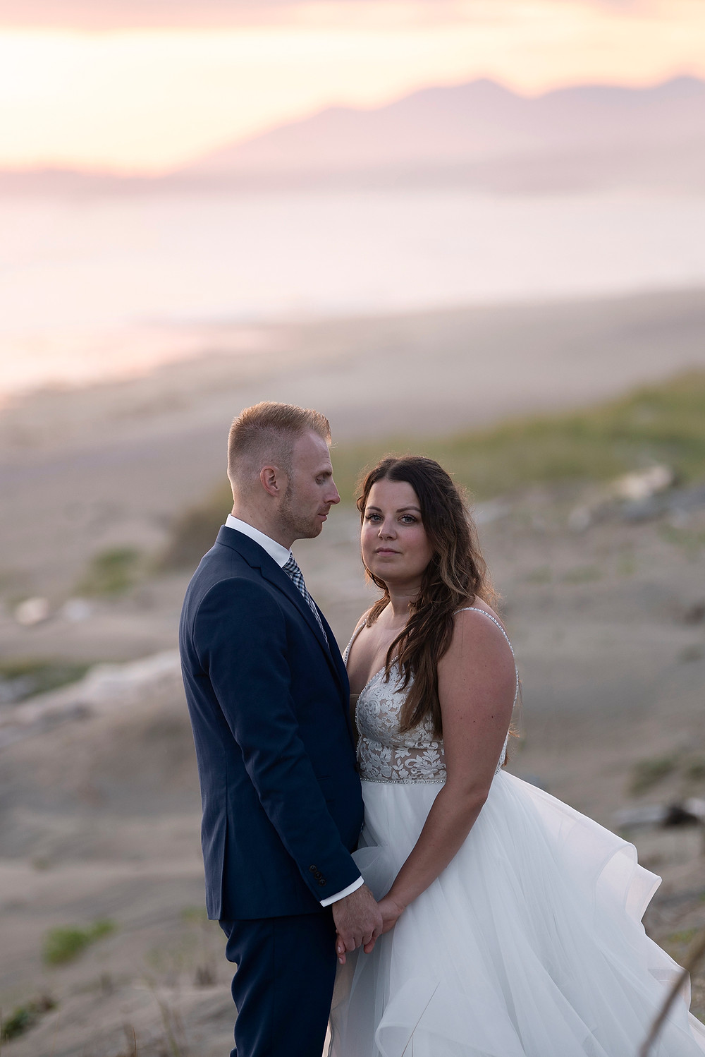Sunset wedding photography in Tofino. Photographed by Kaitlyn Shea.
