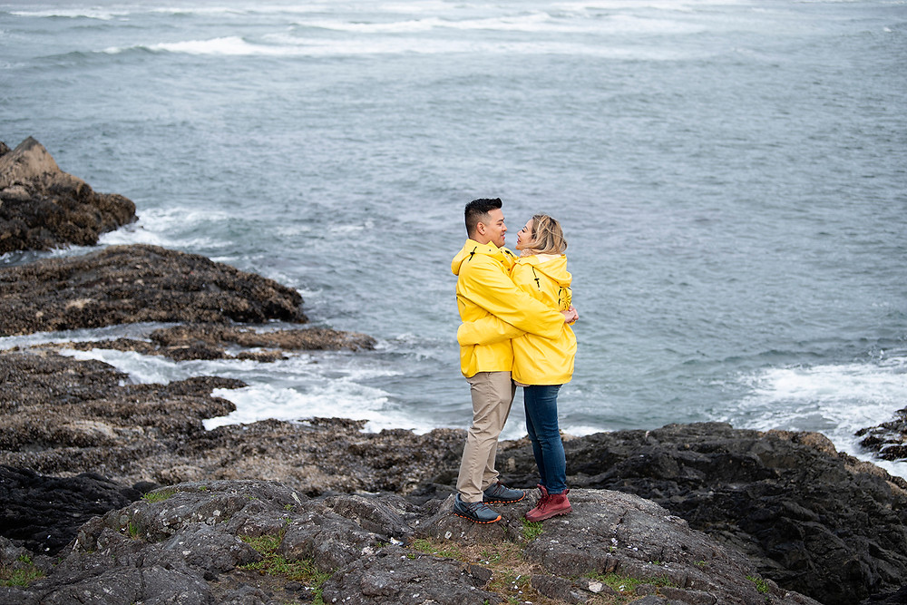 Happy engaged couple embraces after surprise proposal in Tofino. Photographed by Kaitlyn Shea.