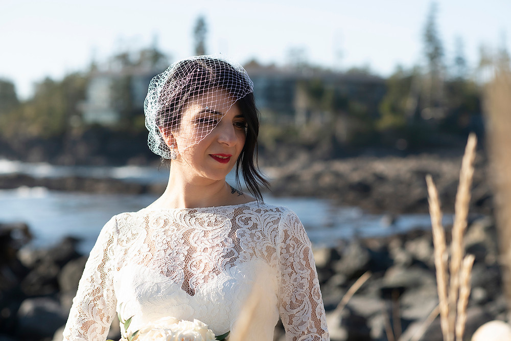 Bride shines radiantly on the beach at her Ucluelet elopement. Photographed by Kaitlyn Shea.