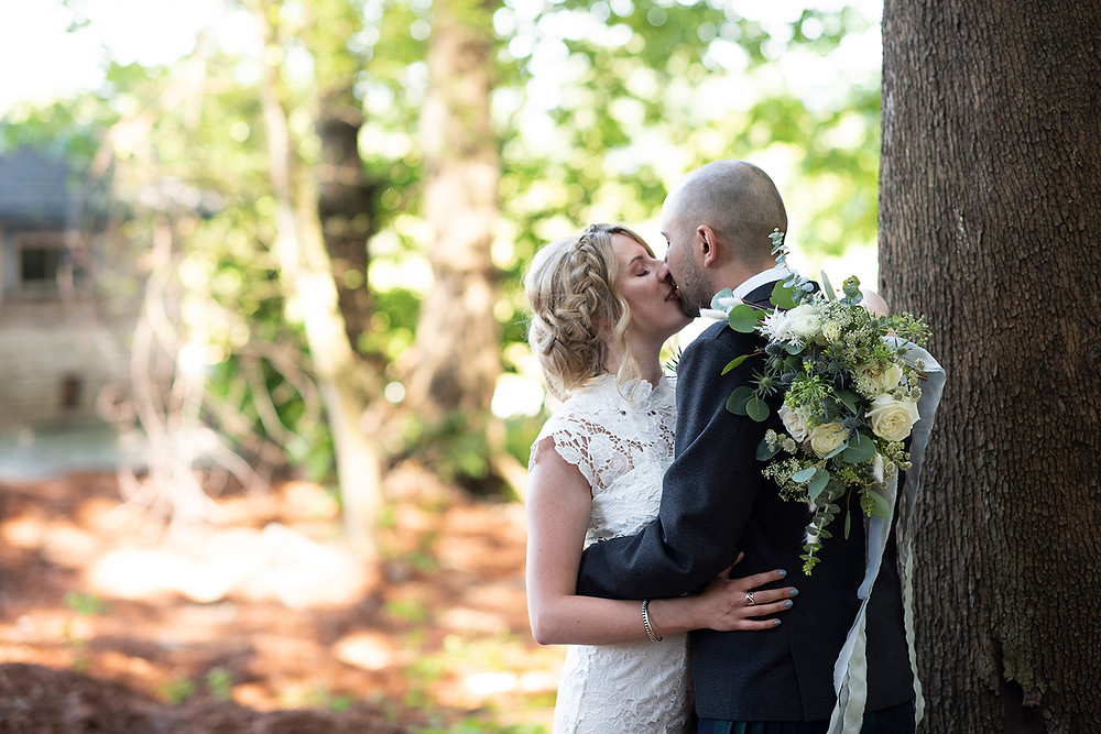 bride kisses groom at their Sea Cider wedding in Victoria. Photographed by Tofino photographer Kaitlyn Shea.