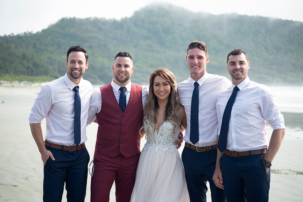 bride and groom and groomsmen at beach wedding in Tofino at Long Beach Lodge. Photographed by Kaitlyn Shea